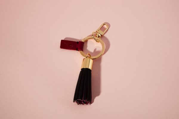 GOLDEN KEY RING BLACK TASSEL